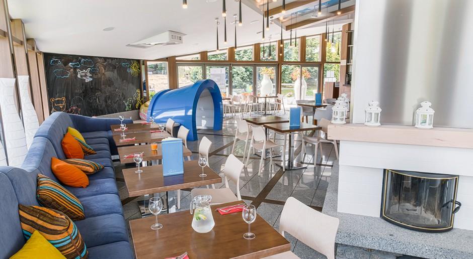 Designerska restauracja nad jeziorem Malta projektu Artpin