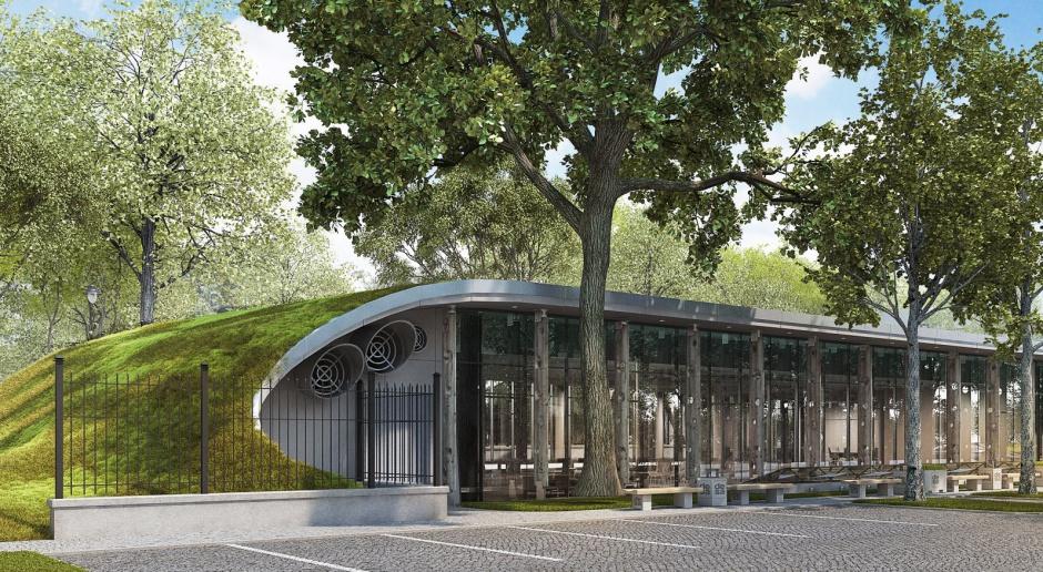 Desa Unicum w przeszklonym pawilonie z zielonym dachem. To projekt Arch Magic