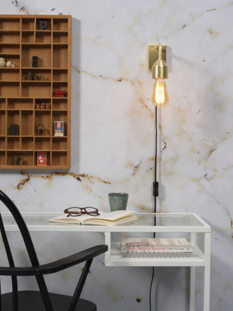 Złoto we wnętrzach: stylowe lampy w klimacie światowych metropolii
