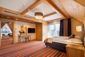 Hotel Bania Thermal & Ski zachwyca wnętrzem! To miks folkloru, elegancji i spersonalizowanego designu