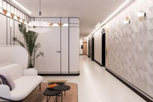 Wnętrza z pracowni Jana Sikory i inspiracje modernizmem w nowym projekcie Bouygues Immobilier Polska w Gdyni